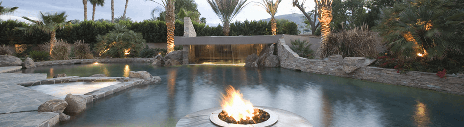 luxurious flag stone swimming pool with built-in firepit