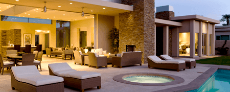 Poolside view of the interior living space of a modern upscale home open concept lanai style.